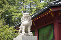Lion guard stone sculpture of near japanese temple wall Stock Photography