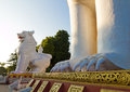 Lion guarded entrance gate to mandalay hill giant at sunset burma Stock Images