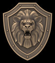 Lion head blazon bronze sculpture of a on medieval shield Royalty Free Stock Image