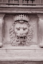 Lion head on the facade of pitti palace museum florence italy in black and white sepia tone Stock Photos
