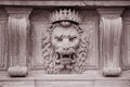 Lion head on the facade of pitti palace museum florence italy in black and white sepia tone Royalty Free Stock Photo