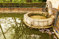 Lion pool alcazar royal palace seville spain statue fountain reflection fish flowers garden andalusia originally a moorish fort Stock Image