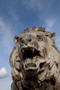 Lion sculpture ancient over a blue sky Royalty Free Stock Photo