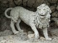 Lion sculpture at a building named grotto in the formal garden of the castle in veitshoechheim Stock Photography
