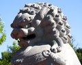 Lion sculpture in chinese garden Images stock