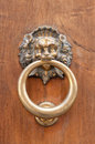 Lion shaped door knocker vintage with ring Royalty Free Stock Photo