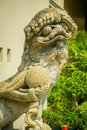 Lion statue in Chinese style in the Thai temple in the royal grand palace Royalty Free Stock Photo