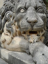 Lion statue grand master palace valletta malta majestic carved stone guarding the entrance to the s garden in Stock Photo
