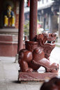A lion under the column of a chinese temple stone carved it functions as protection venue Royalty Free Stock Photography
