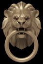 Lions head door handle artistic bronze sculpture of a as a d rendered image isolated on black background Royalty Free Stock Photography