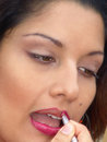 Lipstick a face close up of a fashion model applying Royalty Free Stock Image