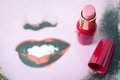 Lipstick red next to painted lips Royalty Free Stock Image