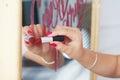 Lipstick writes on mirror