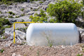 Liquefied gas tank on the stones Stock Image