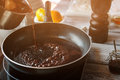Liquid flowing onto frying pan dark boiling on key ingredient for delicious sauce best sort of red wine Royalty Free Stock Photos