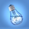 Liquid in a light bulb incandescent filled with on blue background Royalty Free Stock Images