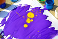 Liquid purple with yellow paint blot on white paper Royalty Free Stock Photo