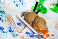 Liquorice Ice Cream with Caramel Topping Stock Images