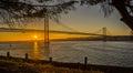 Lisbon Bridge Over tagus river sunset seen from Almada Royalty Free Stock Photo