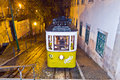 Lisbon at night famous tram portugal december traditional yellow downtown by on december in portugal in the first electrical Royalty Free Stock Images