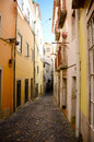 Lisbon portugal cobblestone street in the al fama district of Royalty Free Stock Images
