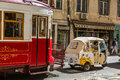 Lisbon, Portugal - May 18, 2017: The famous old tram and Tuk Tuk