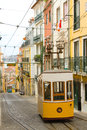 Lisbon tram a yellow in climbing a steep street Royalty Free Stock Photography