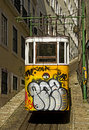 Lisbon tram yellow with graffity in Stock Images
