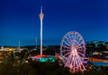 Liseberg amusement park on a summer midnight in gothenburg sweden residential area one one side and an industrial area the Royalty Free Stock Image