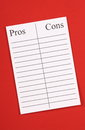 A list of pros and cons an empty on lined paper against red background such lists are used to weigh up decisions in your business Royalty Free Stock Photos
