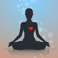 Listen to your heart. Lotus position Royalty Free Stock Photo
