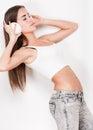 Listen up portrait of a slender brunette beauty listening to music in headphones Royalty Free Stock Image