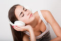 Listen up portrait of a slender brunette beauty listening to music in headphones Stock Image
