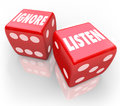 Listen vs ignore red dice words paying attention and on two d to illustrate the choice to pay or avoid listening to a person or Stock Photography
