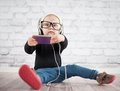 Listener cute baby girl with mp player Royalty Free Stock Photography