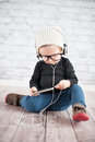 Listener cute baby girl with mp player Stock Images