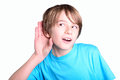 Listening child listens with hand near ear on white background Stock Photo