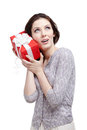 Listening to the gift wrapped in red paper Royalty Free Stock Image