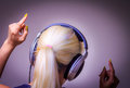 Listening to music dancing girl wearing headphones Stock Photo