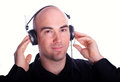 Listening to the music full isolated portrait of a bald caucasian man Stock Photos