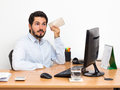 Listening to voicemail, Man sitting at workstation Royalty Free Stock Photo