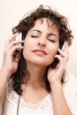Listening a young woman music with headphones Royalty Free Stock Photo