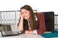 Listless young woman in office Royalty Free Stock Images