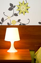 A lit bedside lamp Royalty Free Stock Photo