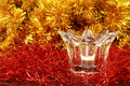 Lit candle in a transparent glass candlestick Stock Photos