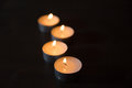 Lit candles one after the other Royalty Free Stock Photo