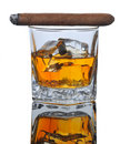 Lit Cigar on Whiskey Glass Royalty Free Stock Images