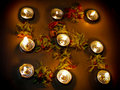 Lit diya on hindu religious floral pattern Stock Images