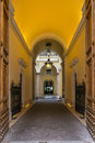 Lit passage inside a building in rome view of italy Stock Image