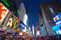 Lit up New York Time Square in the Evening with traffic congestion and human crowd
